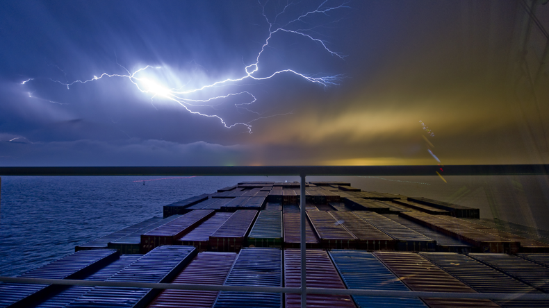 Containership deck and stormy sky