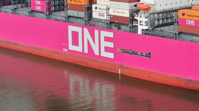 ONE name painted on side of ship