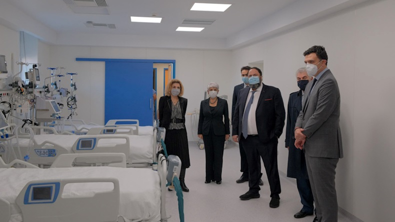 Angeliki Frangou (second from left) and Evangelos Marinakis (fourth from left) attend the unveiling of the new ICU beds, inaugurated by Greece's health minister