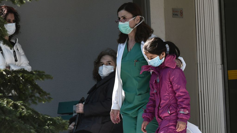 Masks on at a hospital in Thessaloniki, by Sakis MIitrolidis/AFP via Getty Images