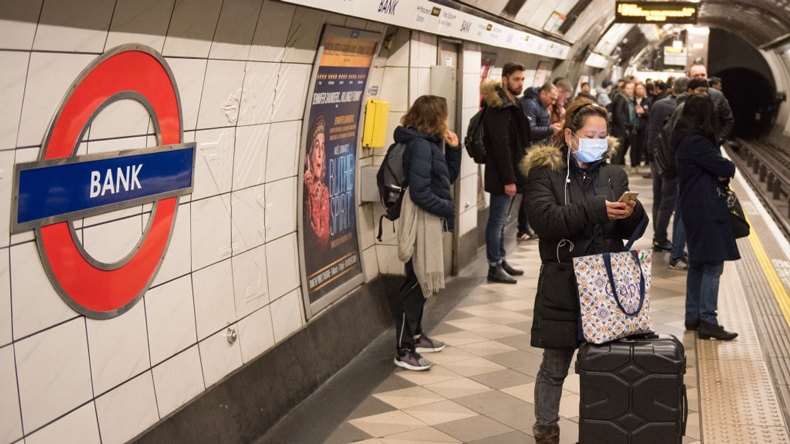 Woman in anti-coronavirus mask on London Tube. John Keeble / Getty Images