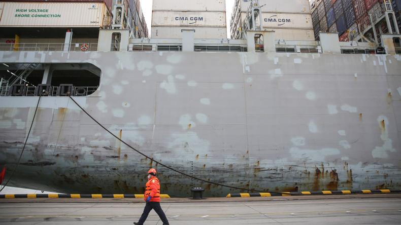 Qingdao dock worker in anti-coronavirus mask