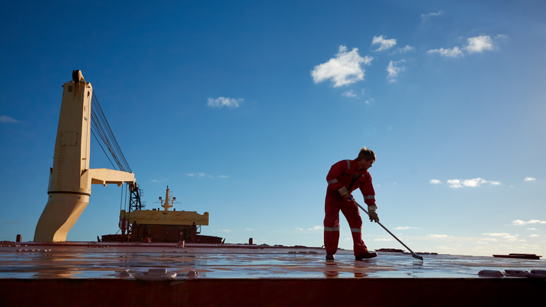 Seafarer working on deck in the Atlantic. Credit Denys Yelmanov/Shutterstock.com