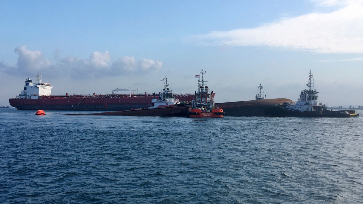 Singapore tanker and dredger collision