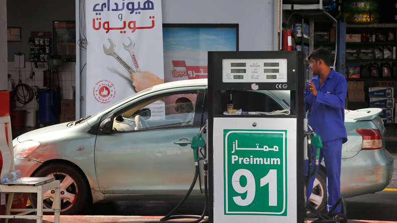 A worker refuels a car at a gas station in Jiddah, Saudi Arabia, Monday