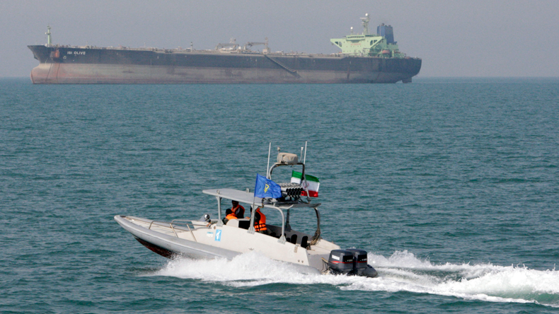 Iranian Revolutionary Guard speedboat with oil tanker