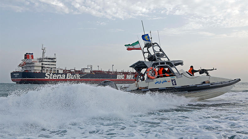 A picture taken on July 21, 2019, shows Iranian Revolutionary Guards patrolling around the British-flagged tanker Stena Impero as it's anchored off the Iranian port city of Bandar Abbas.