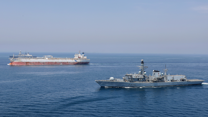 Royal Navy warship escorts tanker
