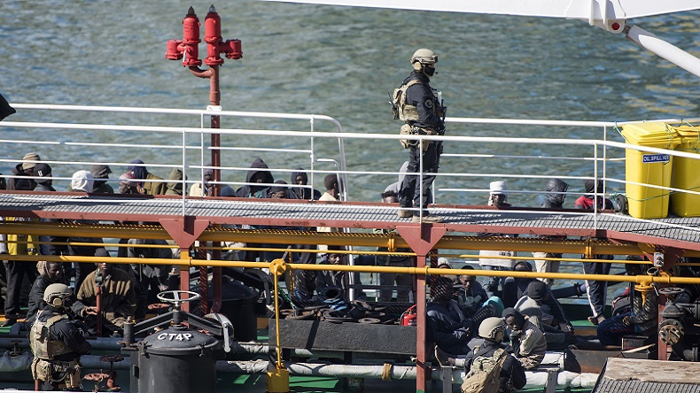 Armed forces stand onboard the Turkish oil tanker El Hiblu 1, which was hijacked by migrants, in Valletta, Malta, Thursday March 28, 2019. A Maltese special operations team on Thursday boarded a tanker that had been hijacked by migrants rescued at sea, and returned control to the captain, before escorting it to a Maltese port. (AP Photo/Rene' Rossignaud)