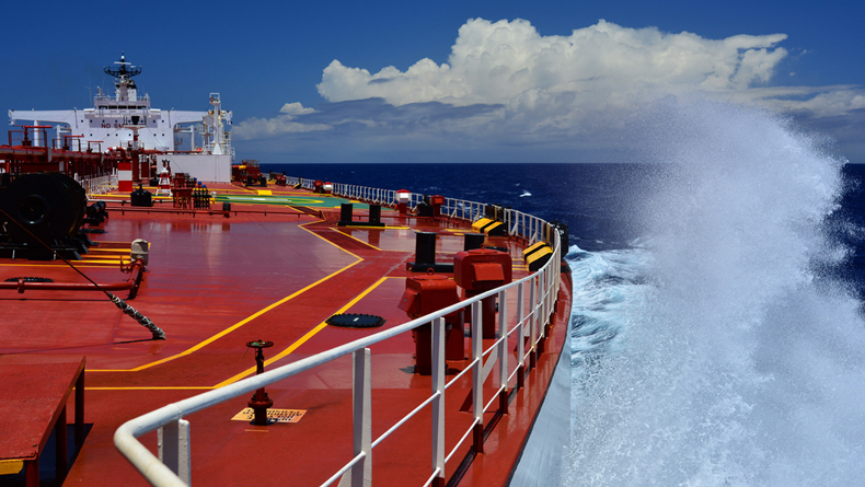 Tanker at sea, looking back down the deck