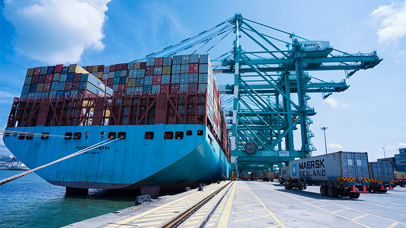 One of the biggest containerships in the world, Morgens Maersk, lies alongside at PTP, Malaysia.
